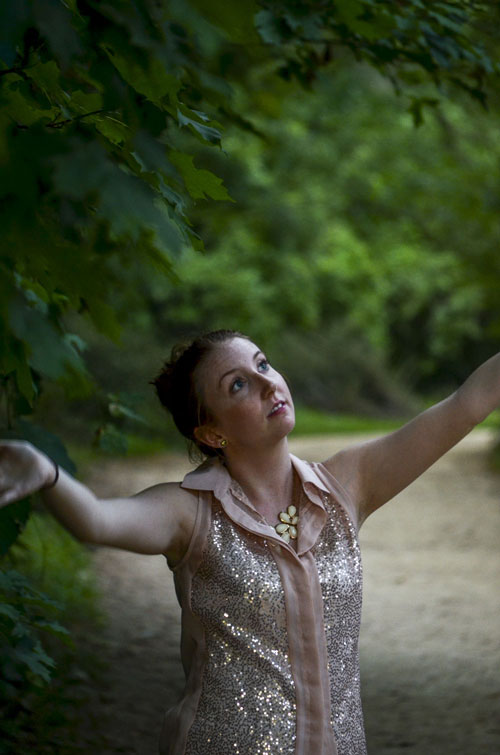 Amber-Looks-Up-In-Woods-Arms-Raised