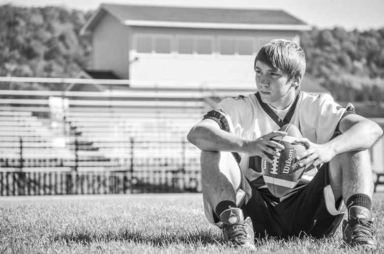 Soldiers-Grove-Jake-Senior-Photos-On-Field-Football-SM